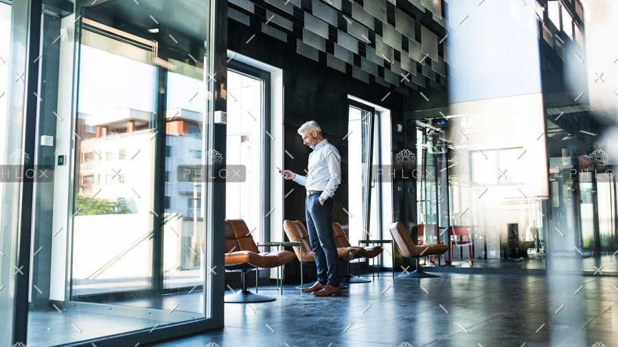 demo-attachment-30-Mature-businessman-with-smartphone-in-the-office.