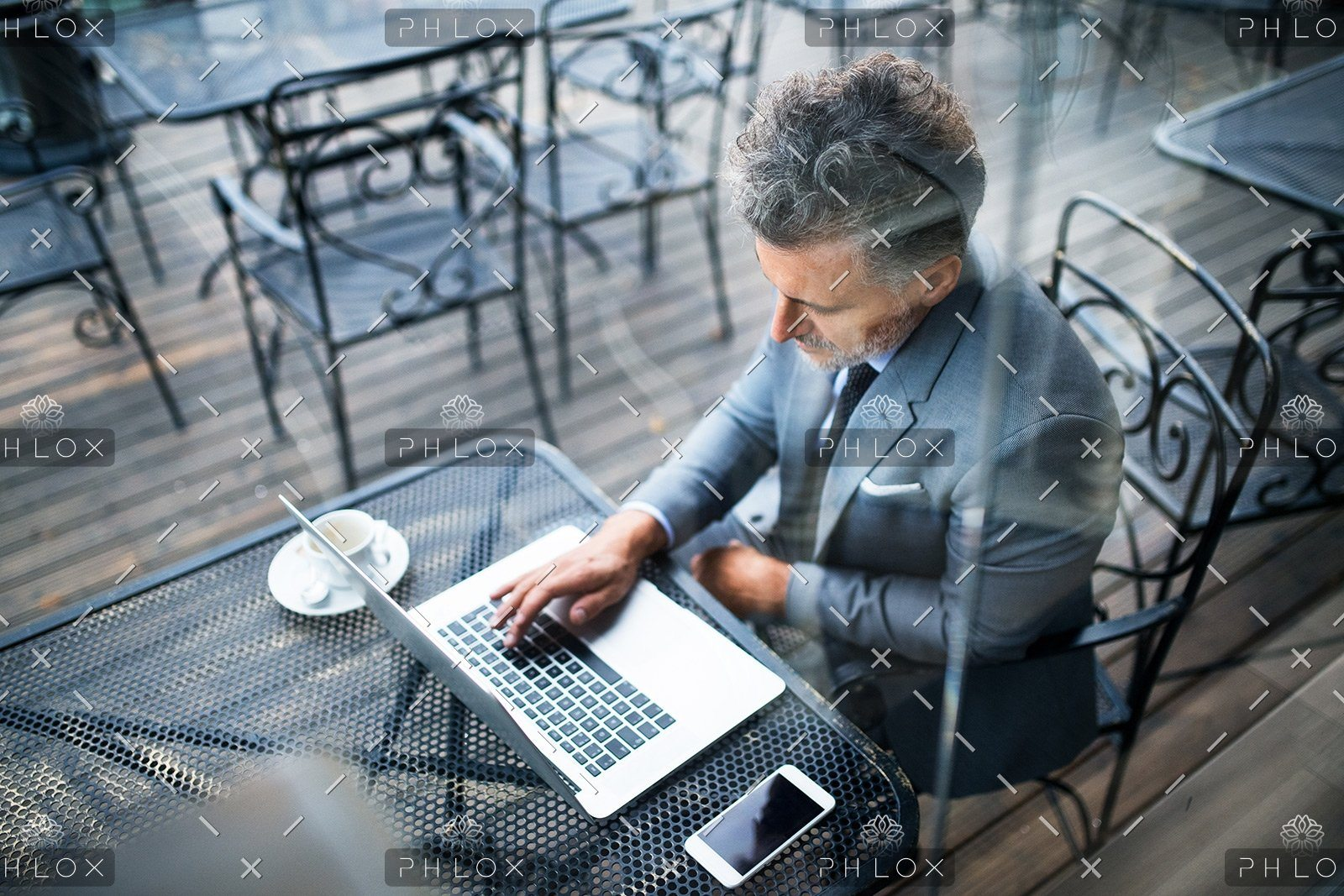 demo-attachment-24-mature-businessman-with-laptop-outside-a-cafe-PXAVBAC